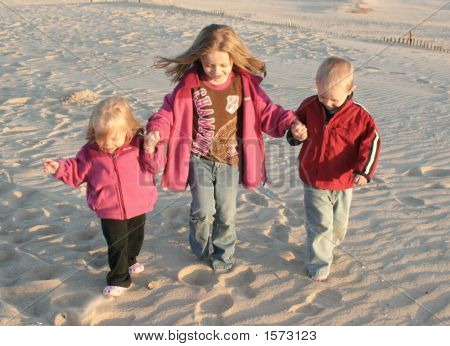 Kids Walking On The Beach Together