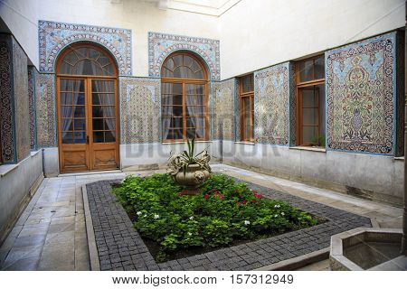 LIVADIA, CRIMEA - AUGUST 26, 2016: Beautiful courtyard of the Livadia palace, summer retreat of the last Russian tsar, Nicholas II. Crimea, on August 26, 2016.
