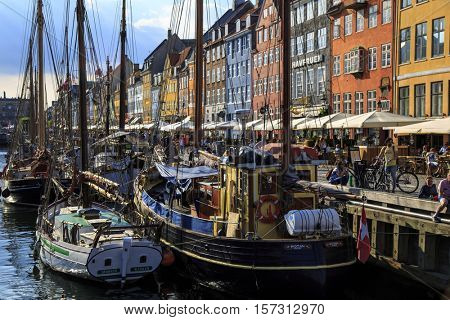 COPENHAGEN, DENMARK - JUNE 07, 2016:  Beautiful houses at Nyhavn a 17th-century waterfront, canal and entertainment district in Copenhagen, Denmark on June 07, 2016.