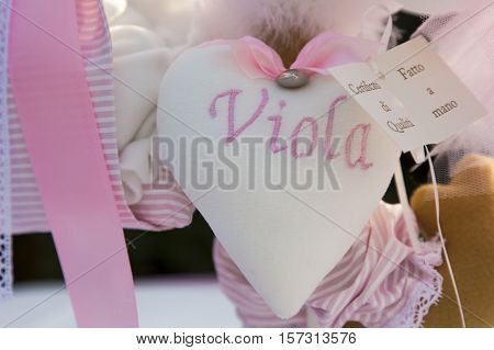 View a cloth heart with the name as a decoration