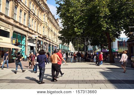 Cardiff, Wales, UK, September 14, 2016 :  People walking in the pedestrian precinct of Queen Street in the city centre