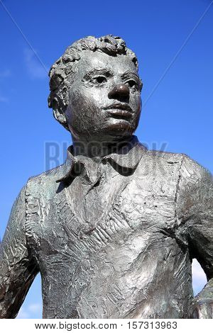 Swansea, Wales, UK, February 23, 2016 : Dylan Thomas statue which stands outside the Dylan Thomas Theatre in the Marina. Sculpted by John Doubleday it was unveiled in 1984 as a memorial to the much loved poet and writer