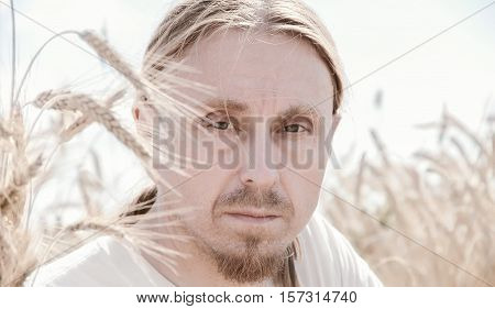 portrait of the Russian men in the field wheat, peasant in a field