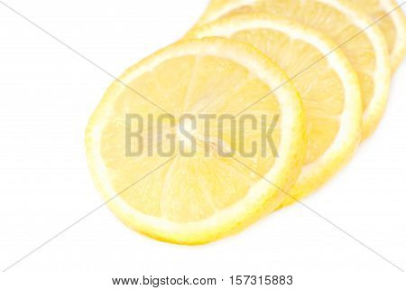 yellow slice of lemon on white background