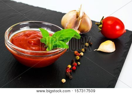 Green Fresh Basil with Tomato Sause and Ketchup Studio Photo