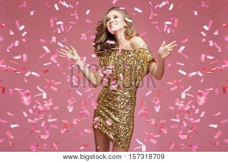 Young Girl In An Evening Dress Celebrating.