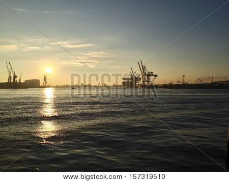 Sunset Over A Harbour And Docks