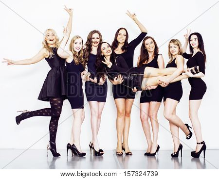 Many diverse women in line, wearing fancy little black dresses, party makeup, vice squad concept, lifestyle people poster
