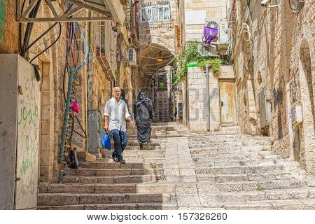 JERUSALEM, ISRAEL - JUNE 19, 2015: People passing at the staircase street of the old town.