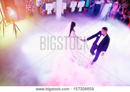 Amazing First Wedding Dance Of Newlywed With Different Colourful Light And Heavy Smoke On Restaurant
