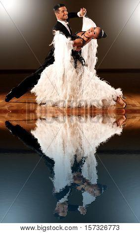 Professional ballroom dance couple preform an romantic exhibition dance poster