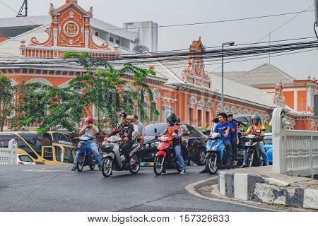 Bangkok, Thailand - January 8, 2016: Side view of busy traffic in Kalayana Maitri Road is one of the famous streets with government buildings