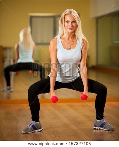 Fit Woman Work Out In Gym Making Squat