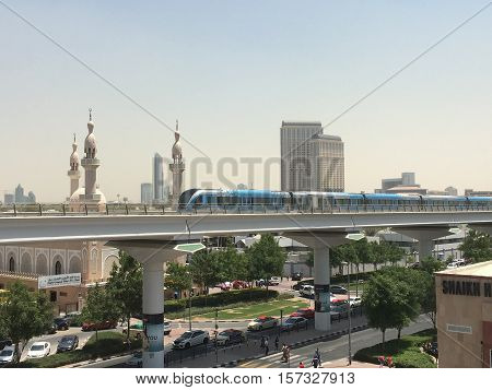 DUBAI, UAE - AUG 26: Train approaching Oud Metha Metro Station in Dubai, UAE, on Aug 26, 2016. Guinness World Records declared it the worlds longest fully automated driverless metro network.