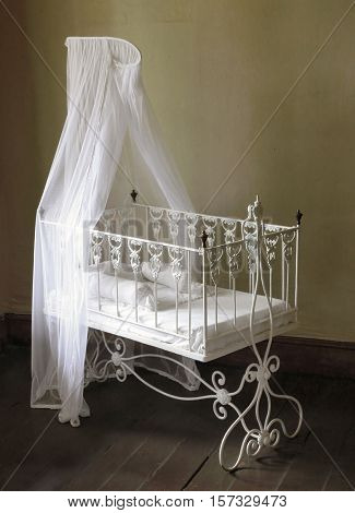 Children bed. Antique furniture from 19th century.