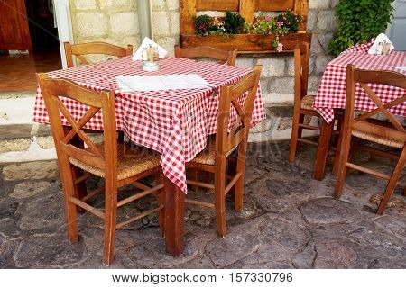 Traditional Greek Tavern Tables Covered in Red and White Checkered Gingham Tablecloth