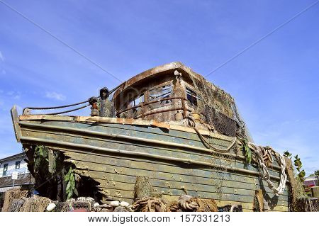 An old shipwrecked boat in a harbour