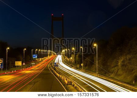 Long exposure of the Severn Bridge at night from English side with light trails
