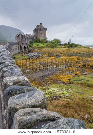 Medieval Eilean Donan castle in Dornie, Scotland at low tide
