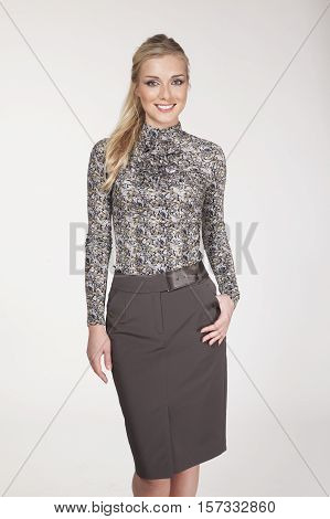 woman with straight hair style in long sleeve tight blouse and office skirt