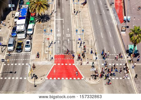 Barcelona, Spain - May 27, 2016: people crossing the street. Passeig de Colom, Barcelona