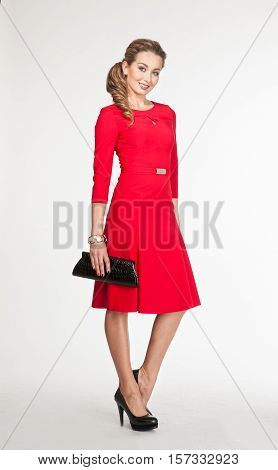 woman in official formal red dress high heel shoes. full length body portrait isolated on white