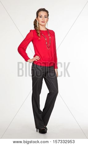 woman in official red blouse stretch trousers high heel shoes. full length body portrait isolated on white