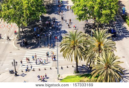Barcelona, Spain - May 27, 2016: people crossing the street. La Rambla de Santa Monica