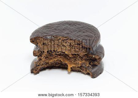 bitten chocolate alfajor isolated on white background