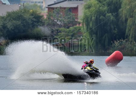 BUCHAREST ROMANIA -SEPTEMBER 23: Professional jet ski riders compete at the Palazz Jet Ski Championship 2016 at Fundeni lake in Bucharest on september 23 2016 in Bucharest Romania