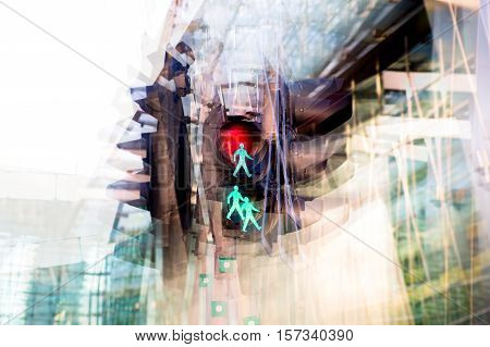 Multiple exposure effect image. Traffic light showing red against of modern office block building.  Business and modern life concept.