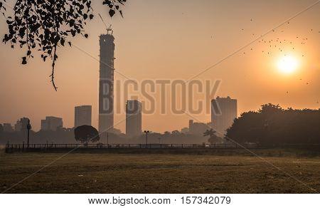 Kolkata cityscape at sunrise on a misty winter morning. Photograph taken from Kolkata Maidan area.