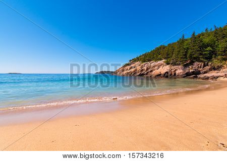 Sand Beach at Acadia National Park Maine. With calm still water.