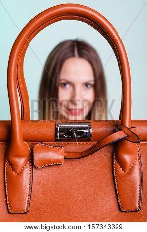 Woman Holding Brown Leather Handbag.