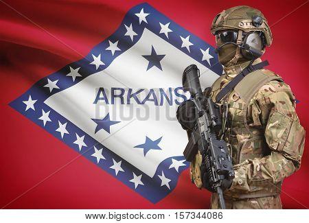 Soldier In Helmet Holding Machine Gun With Usa State Flag On Background Series - Arkansas