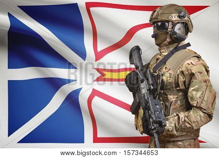 Soldier In Helmet Holding Machine Gun With Canadian Province Flag On Background Series - Newfoundlan