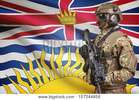 Soldier In Helmet Holding Machine Gun With Canadian Province Flag On Background Series - British Col