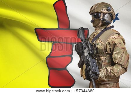 Soldier In Helmet Holding Machine Gun With Canadian Province Flag On Background Series - Nunavut