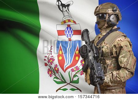 Soldier In Helmet Holding Machine Gun With Canadian Province Flag On Background Series - Yukon