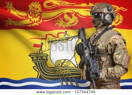 Soldier In Helmet Holding Machine Gun With Canadian Province Flag On Background Series - New Brunswi