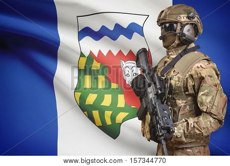 Soldier In Helmet Holding Machine Gun With Canadian Province Flag On Background Series - Northwest T