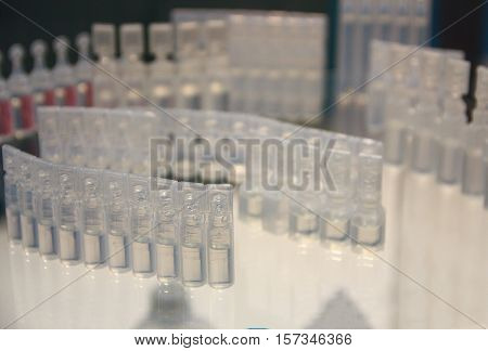 Plastic medical ampoules at the manufacturing stage. Medicine
