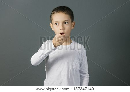 Bad Breath. Halitosis Concept. Child Checking His Breath With His Hand.
