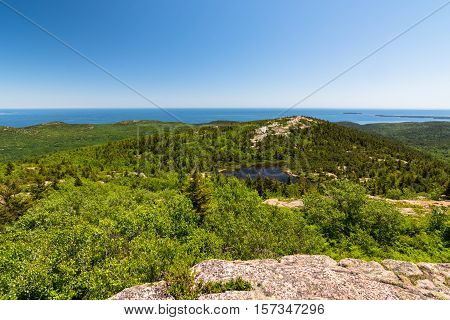 View from the Beehive trail in Acadia National Park looking towards the Atlantic Ocean and Gorham peak