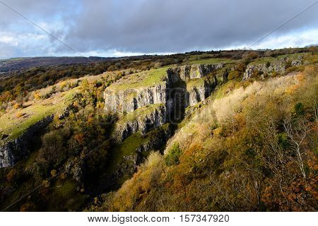 Cliffs of Cheddar Gorge from high viewpoint. High limestone cliffs in canyon in Mendip Hills in Somerset England UK