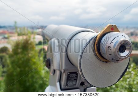 Touristic telescope look at the city with view of Prague closeup grey monoscope on background viewpoint coin operated in panorama observation nature