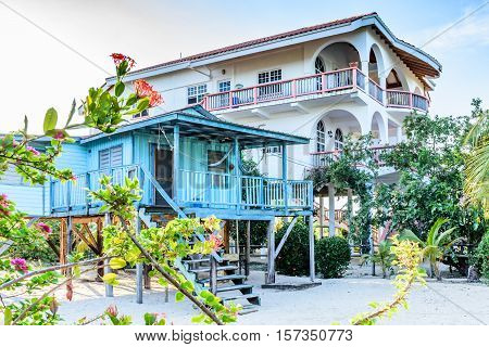 Placencia, Belize - August 29, 2016: Tropical waterside houses on sand next to Caribbean beach in Belize, Central America