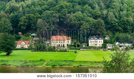 A Picturesque Village Among Green Meadows In The German Province