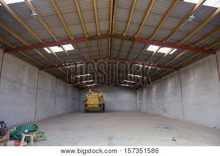 Combine Harvester In The Garage
