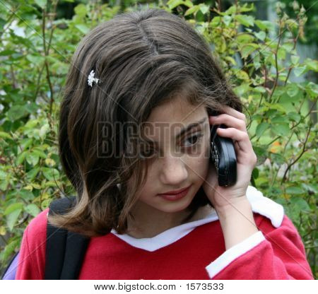 Pretty Young Girl On Cell Phone